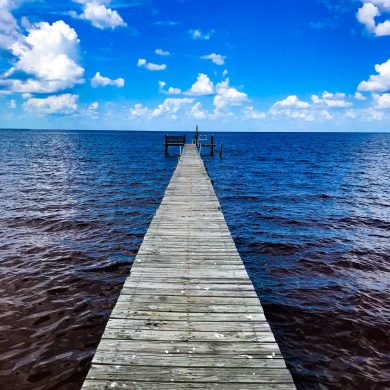 dock-blue-sky-dark-water