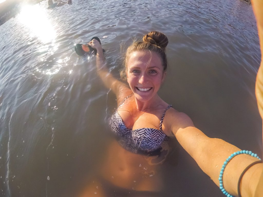 woman-floating-in-dead-sea-taking-selfie
