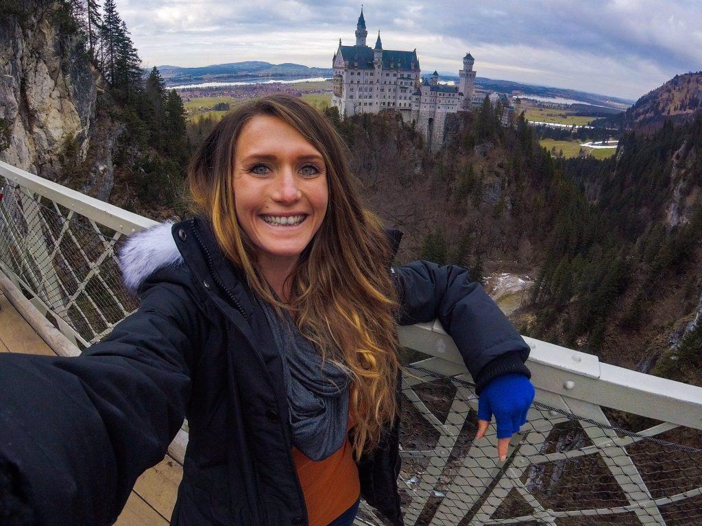 woman-taking-selfie-in-front-neuschwanstein-castle-germany