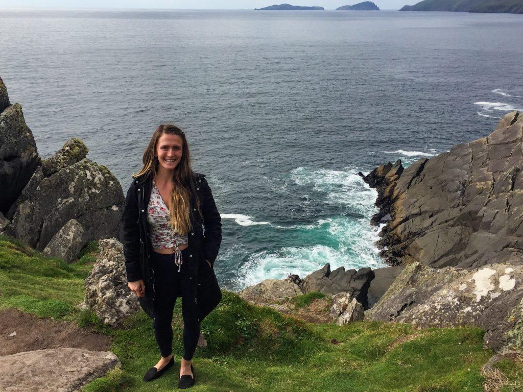 woman-standing-cliff-ocean-slea-head-drive-ireland