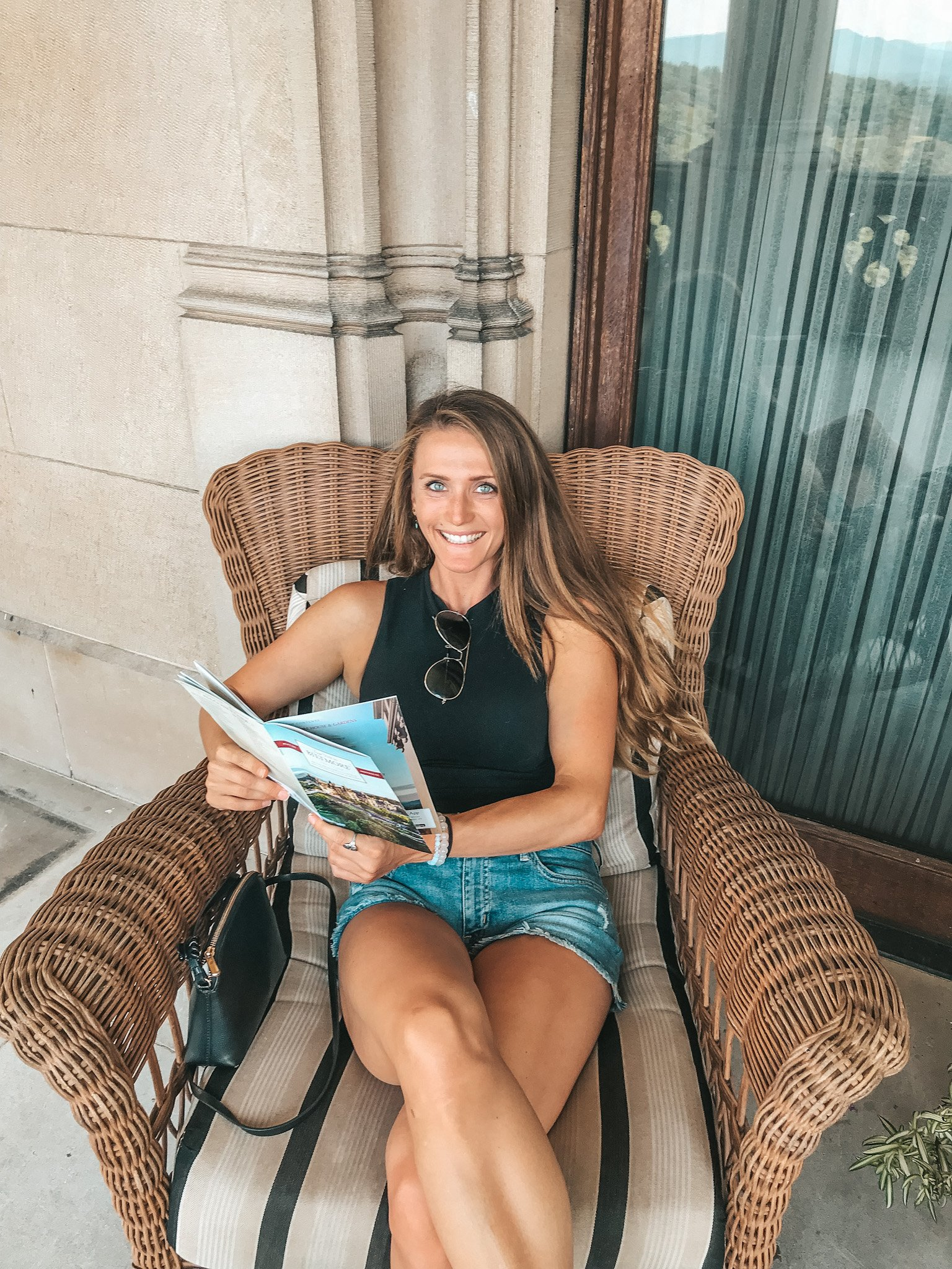 woman reading magazine in chair blue eyes