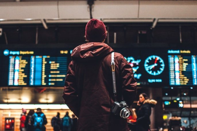 man looking at flight time in airport
