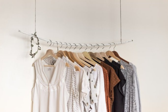 minimalist wardrobe clothes hanging