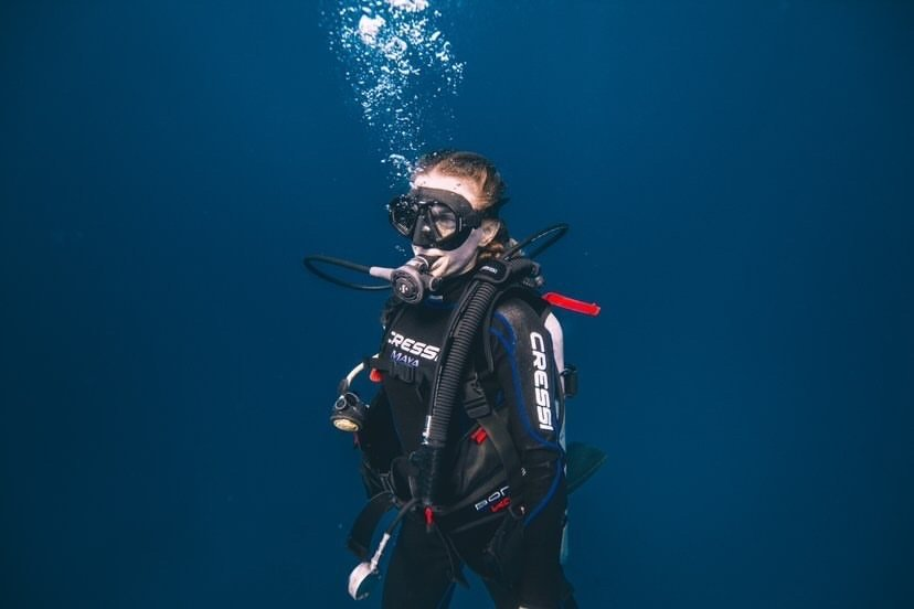woman scuba diving in playa del carmen mexico