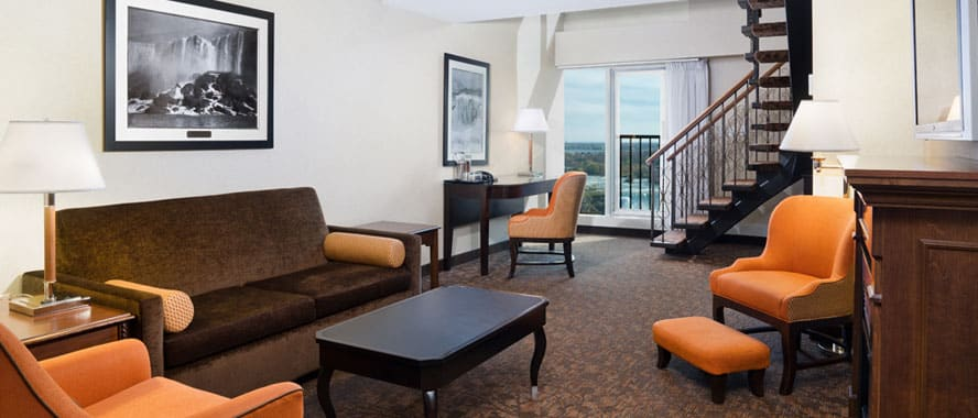 hotel with living room best colors to paint a brown furniture bi level suites sheraton on the falls niagara suite