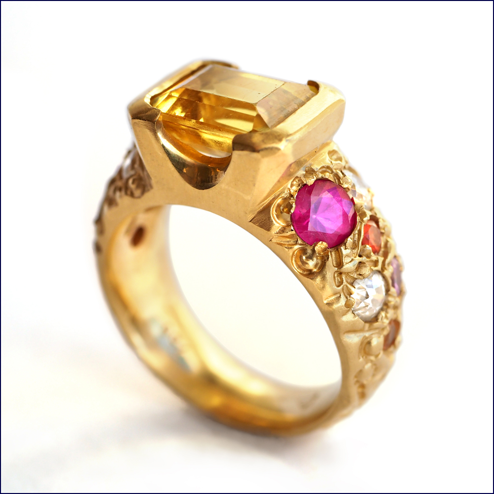 rejewellerated yellow sapphire ring with multi-coloured sapphires and diamonds.