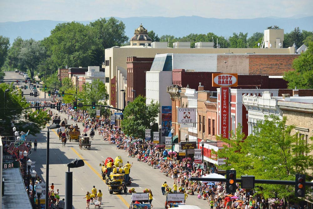 Parade floats and spectators fill Main Street during the 2014 Sheridan WYO Rodeo Parade Friday morning.