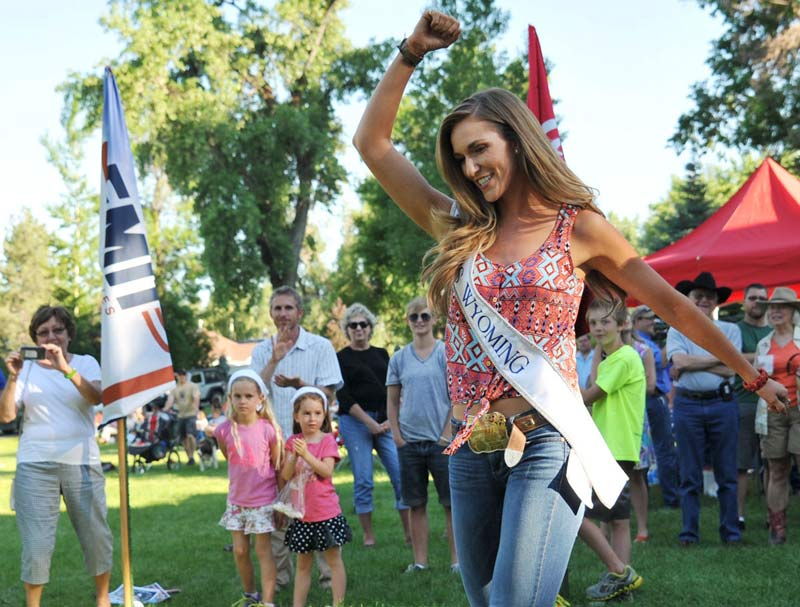 Miss Wyoming 2014 Jessie Allen celebrates after taking her turn in the annual Sheridan-Wyo-Rodeo Boot Kick-off Tuesday at Kendrick Park.