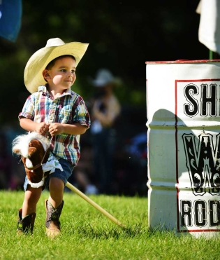 Three-year-old Jamie Craft races his stick horse around the barrel during the annual Sheridan-Wyo-Rodeo Boot Kick-off Tuesday afternoon at Kendrick Park.