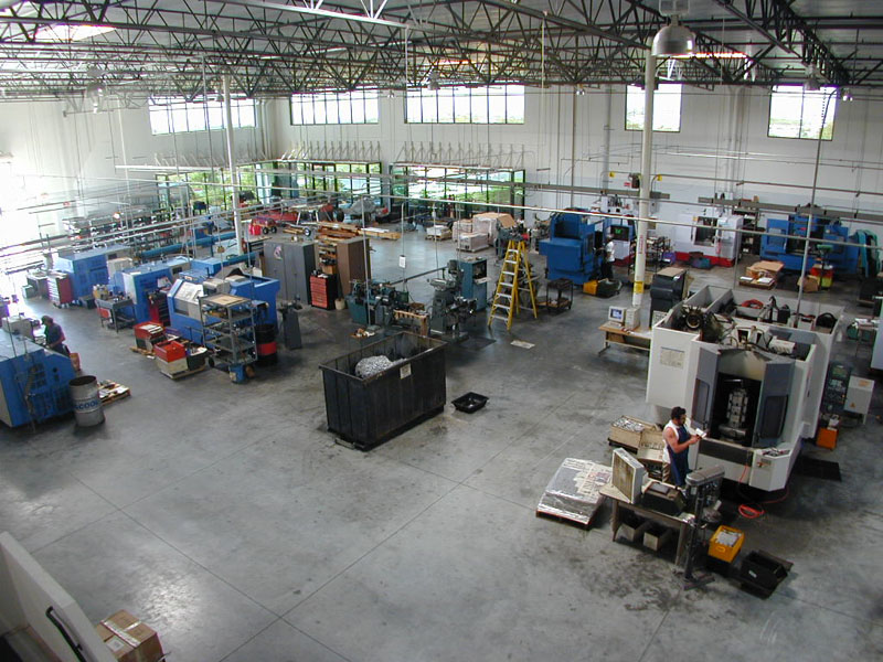 From a similar position but looking toward the west end of the building, the Mazak FH-4800 can be seen in the lower right. To the left is the CNC lathe department.