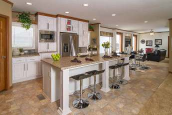 Advantage Kitchen with pantry and stainless steel fridge and white ash cabinets