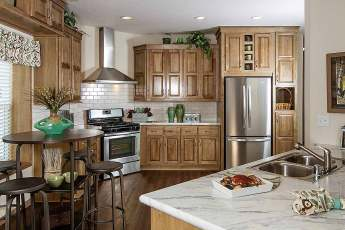 Charlevoix Kitchen with Stainless Steel Fridge Range and Stainless Steel Range Hood