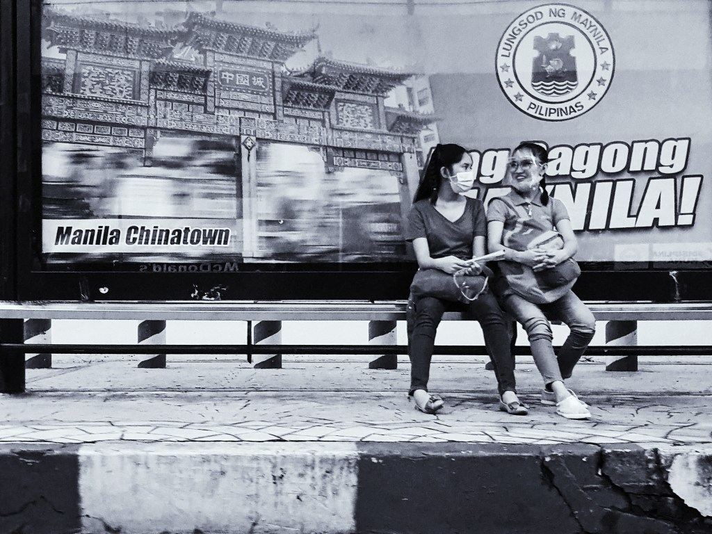 Street Photography in Manila, Philippines - Women Chatting in a Waiting Shed