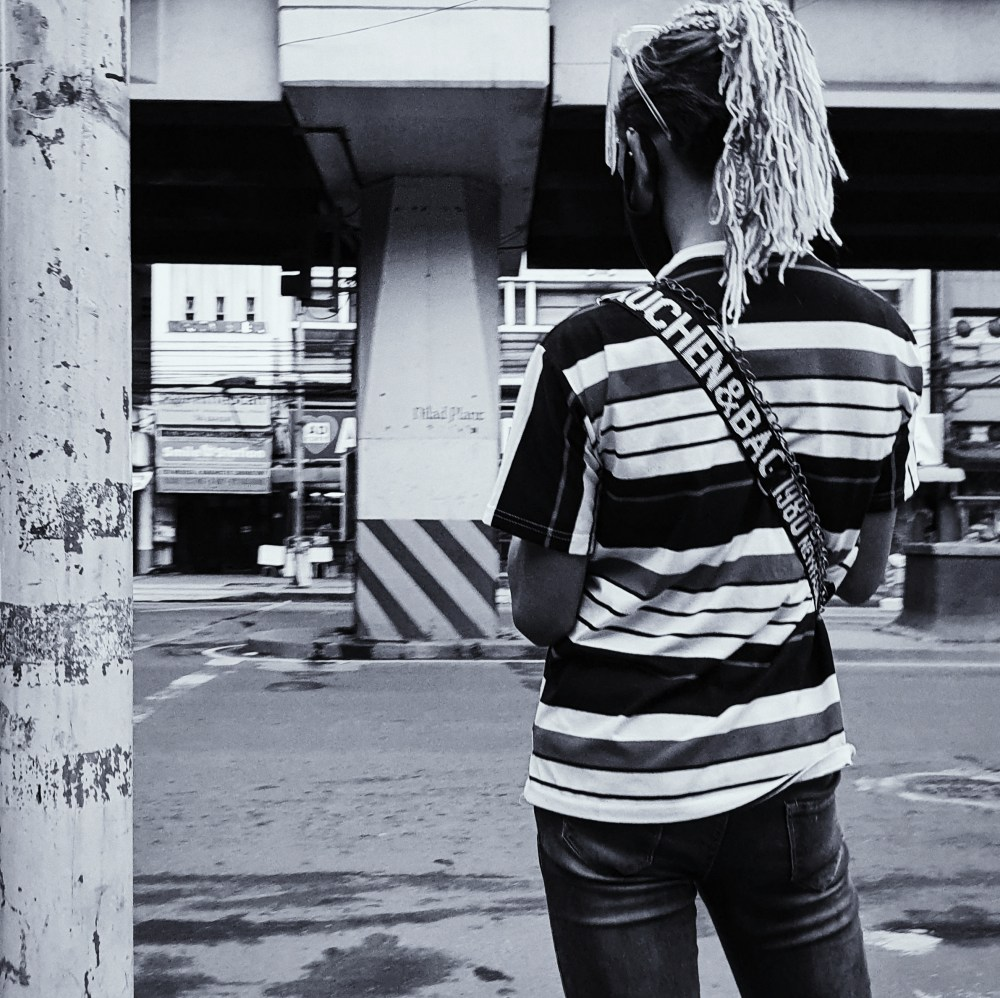Street Photography in Manila, Philippines - Person with Unique Hairstyle Waiting for a Ride