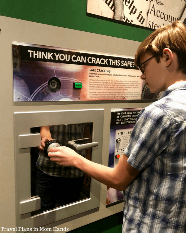 Trying his hand at safecracking in Alcatraz East Crime Museum, naturally one of our activities in Where to Stay, Eat, and Play in Pigeon Forge, TN
