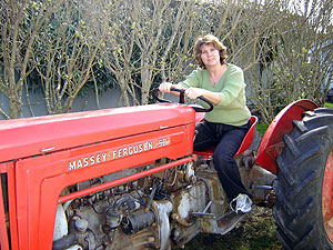 Photo of Sheryl on her 1958 Massey-Ferguson tractor