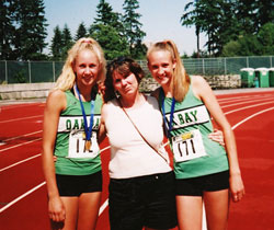 Photo of Sheryl with Cloe and Katie at a BC track championship