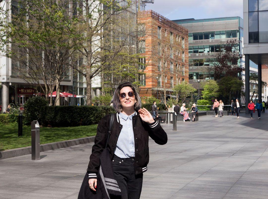 She talks Glam | Black Baseball Jacket | Lawyer Striped sleeveless Shirt | High-rise Black Jeans