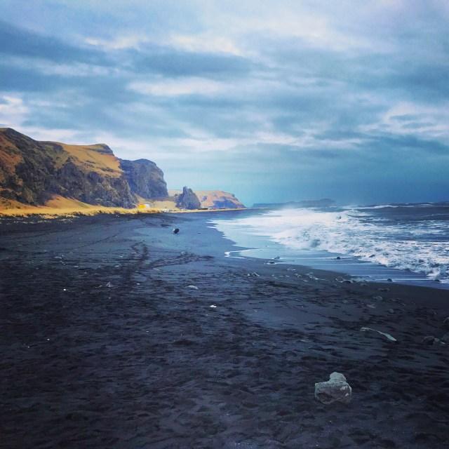 < Black sand beach, Vik >