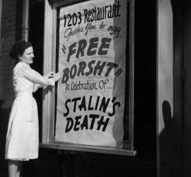Woman Hangs Sign for Free Borsht