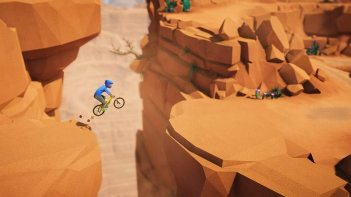 A screenshot from Lonely Mountains: Downhill showing a mountain biker jumping across a canyon.