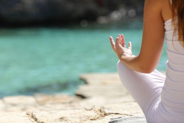 woman-meditating-in-on-beach.jpg