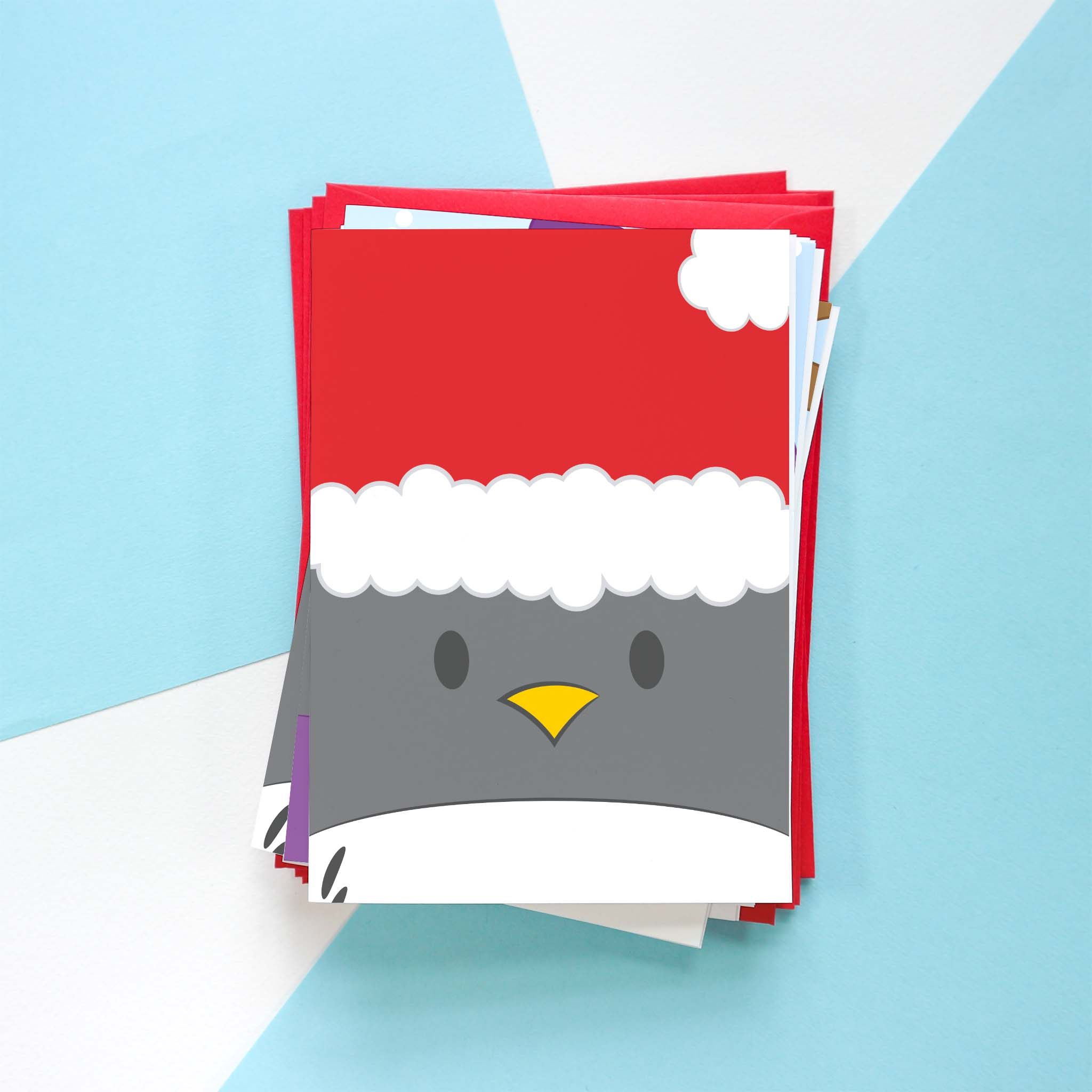 A photo of a Penguin Christmas card design. This design is of Penguin dressed as Santa.