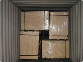 strapped cases packed into the container