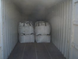 jumbo bags packed with minerals being loaded in a container