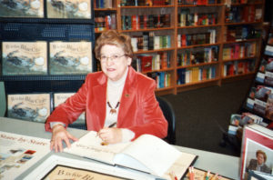 Shirley Menendez signing copies of her book B is for Blue Crab