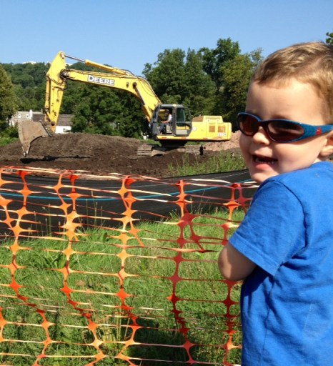 A shovel and a boy wearing sunglasses