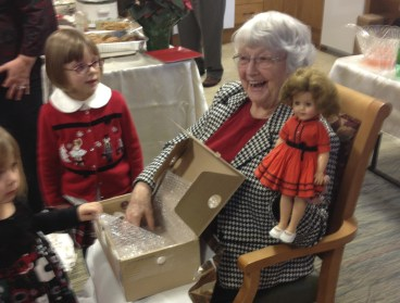 Mother opening her Christmas 2012 present. Her first Shirley Temple doll.