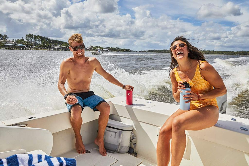 Couple on boat with Hydro Flask in hand