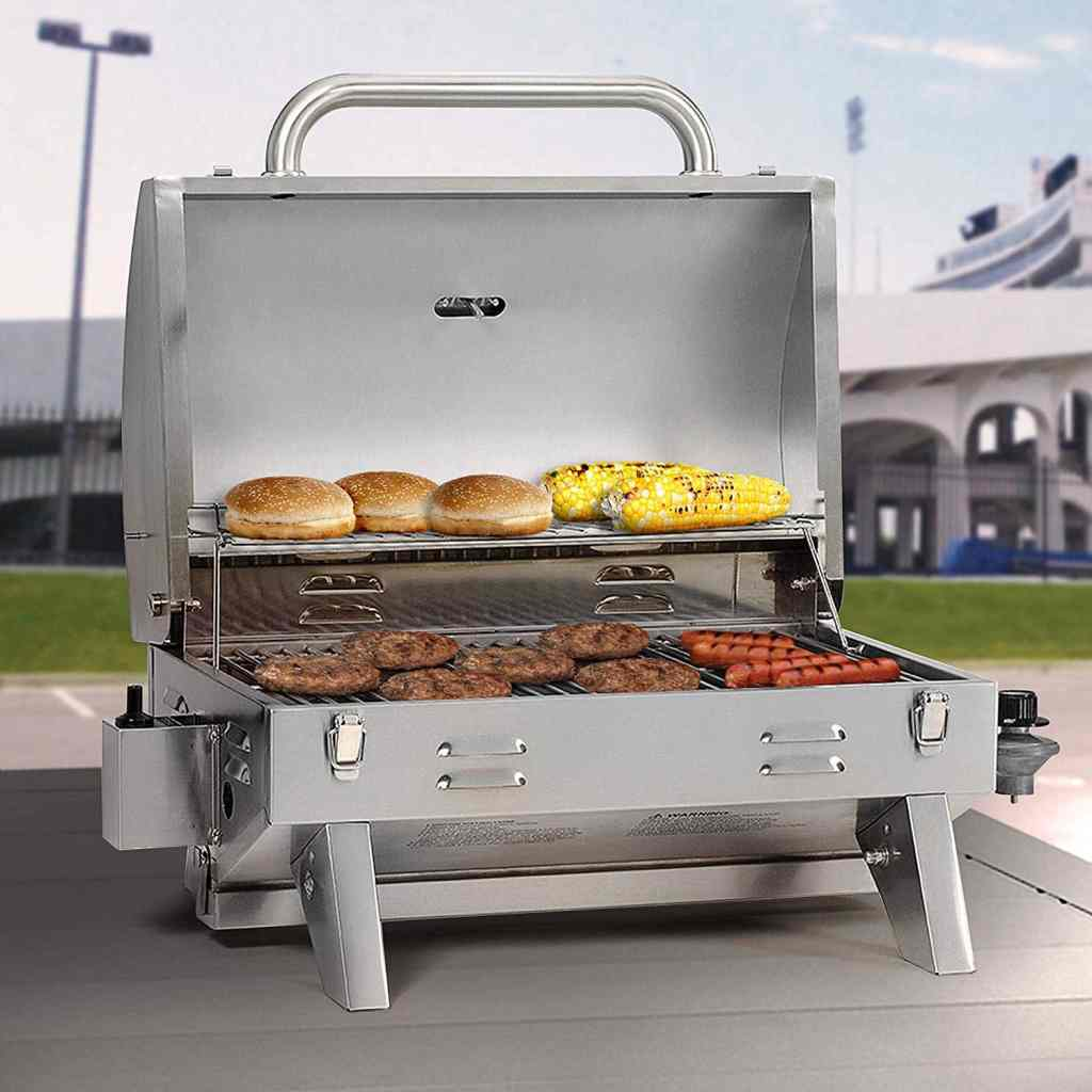 Smoke Hollow tabletop gas grill with food grilling on both racks.