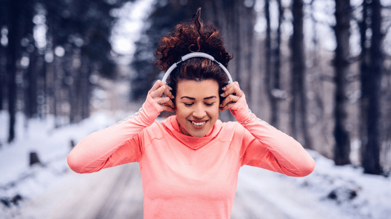 woman listening to music while running