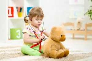 Child checking bear for ear infection