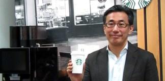 水口貴文CEO(スターバックス コーヒー ジャパン/後方はエスプレッソマシン)