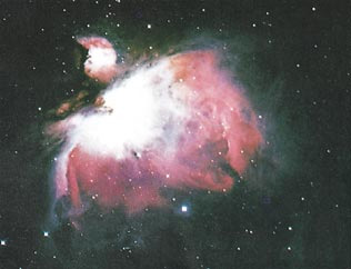 Figure 1: A new star forming out of a cloud of gas and dust (nebula), which is one of the remnants of the 'smoke' that was the origin of the whole universe. (The Space Atlas, Heather and Henbest, p. 50.)