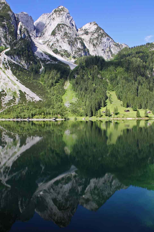 Towering peaks and Alpine huts at Lake Gosau
