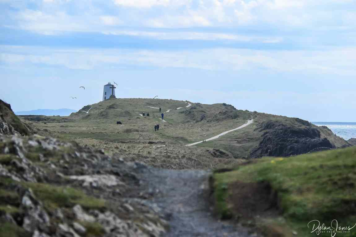 Views across to the lighthouse at the top of Llanddwyn Island Wales