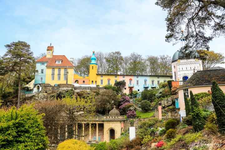 A collection of pastel coloured buildings ta Portmeirion Village