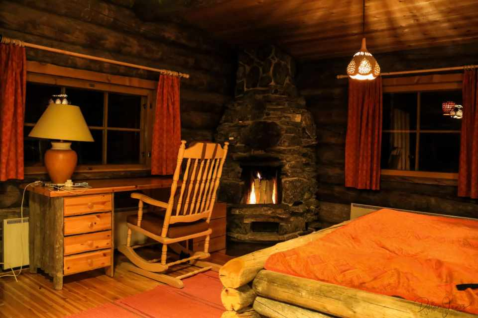 Night time cabin complete with log fire at Kakslauttanen East Village