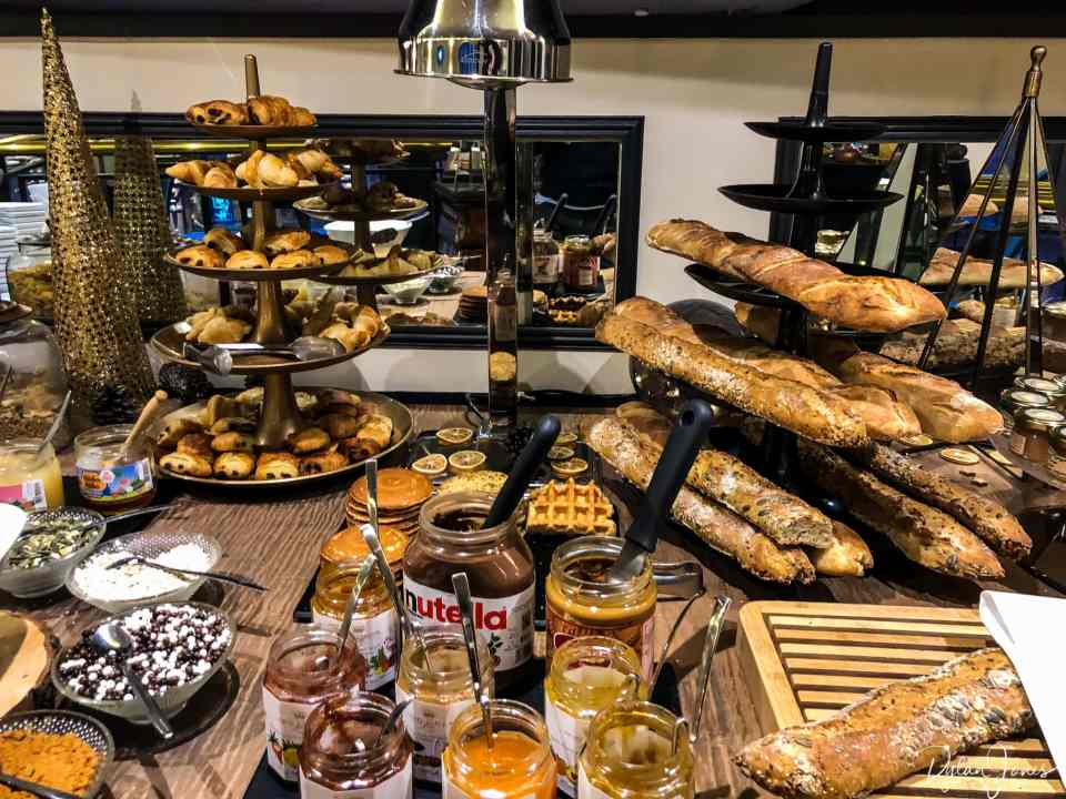 A selection of breads and pastries at the breakfast lounge, Hotel Carlton Lille