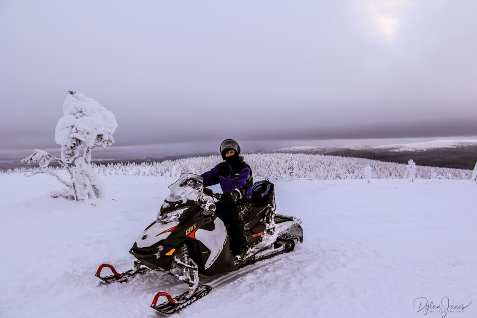 Snowmobile pose at the top of a fell, Saariselkä Lapland