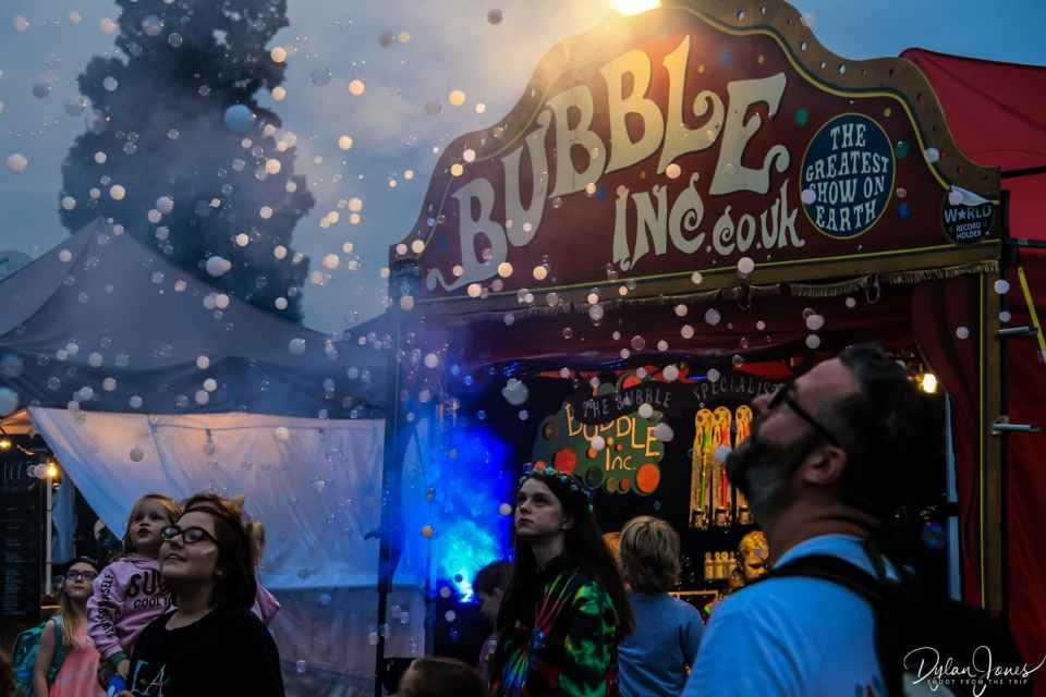 Festival goers at the Bubble Inc stand at Deer Shed Festival