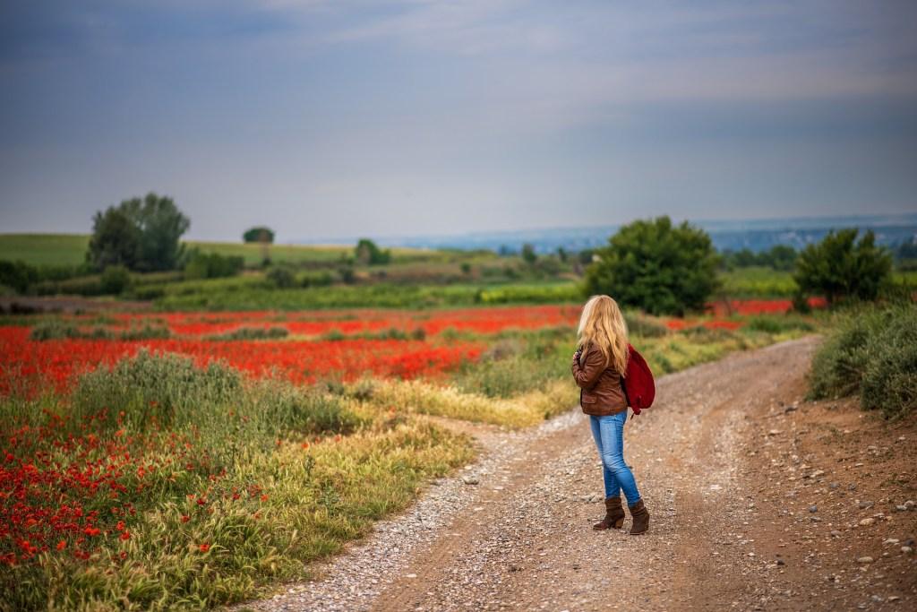 Woman walking in fields.