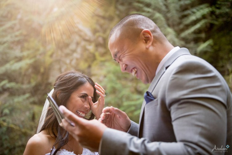 An Asian bride and groom laugh and cry in this close-up photo of their wedding vow ceremony (by Ara Roselani)