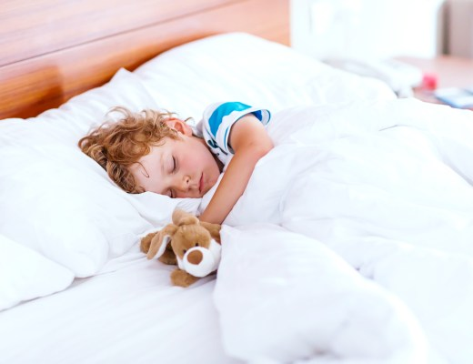 Tags: Themes: Family & Children  Adorable kid boy sleeping and dreaming in his white bed with toy.