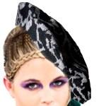 Women wearing purple eyeshawdow with braids wears leopard pring bucket hat in gray and black