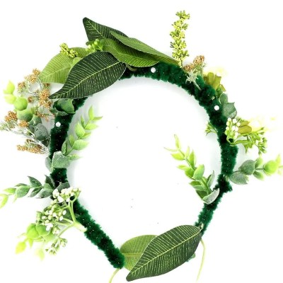 Headband with leaves and yellow flowers protruding througout.